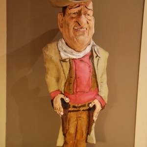 figura de papel mache de john wayne